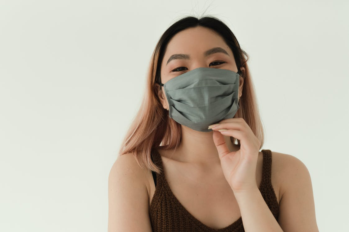 Woman in Brown Top and Gray Mask