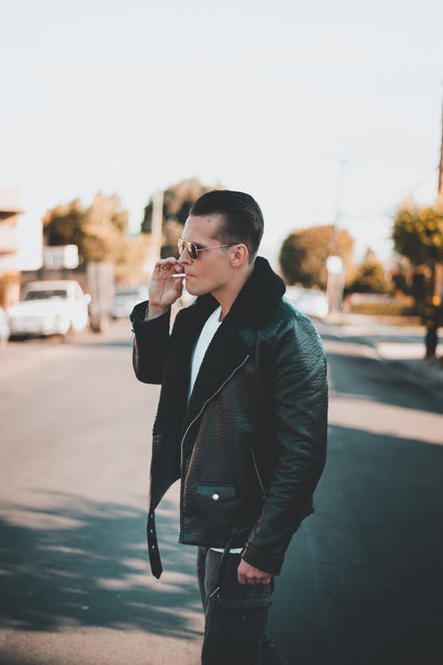 Man Wearing Black Leather Jacket