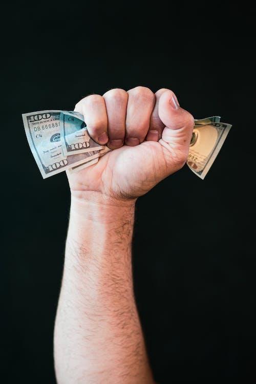 Person Holding 10 Us Dollar Bill