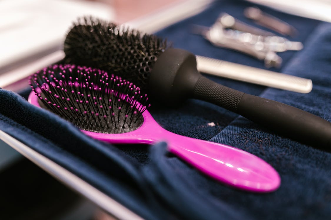 Pink and Black Hair Brush Beside Hair Brush