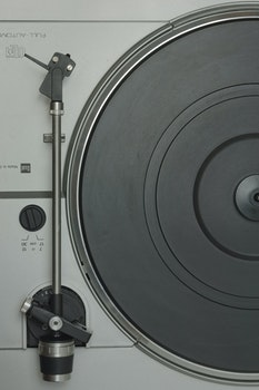 Grey and Black Turntable in a Close Up Photography