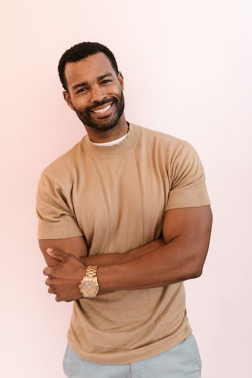 A Bearded Man Wearing a Brown Shirt