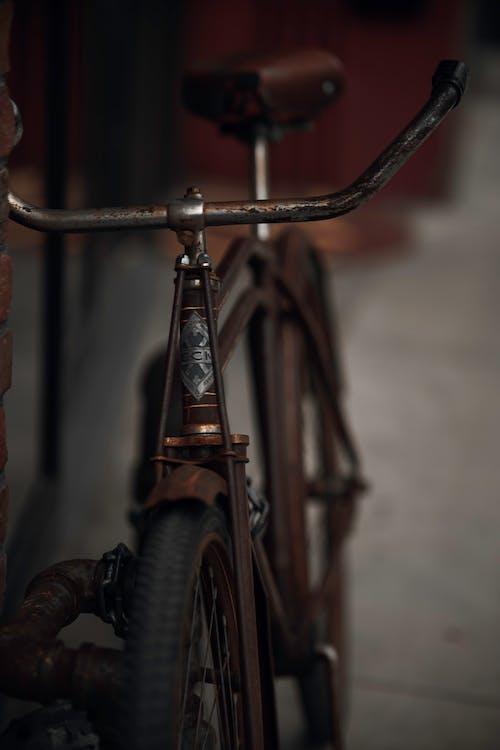 Black Bicycle With Brown Metal Handle Bar