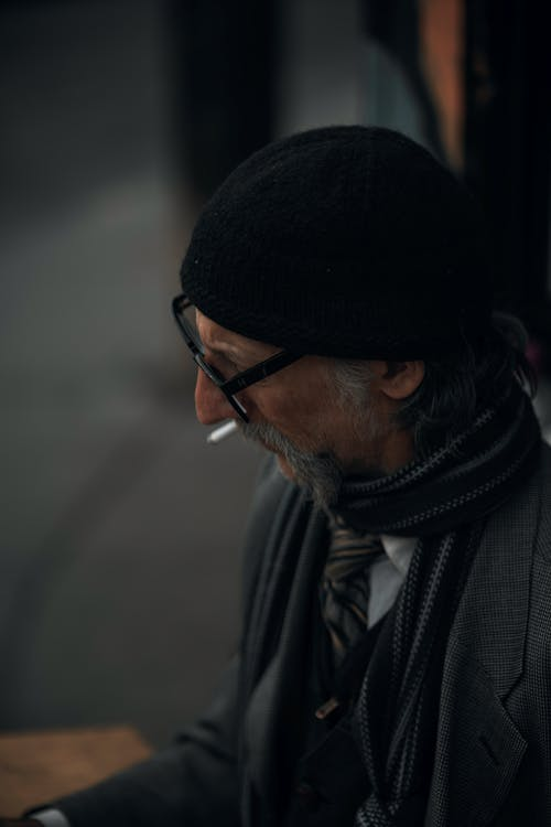 Man in Black Knit Cap and Black Framed Eyeglasses