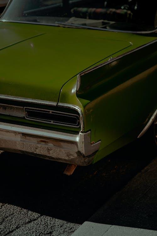 Green Car on Black Asphalt Road