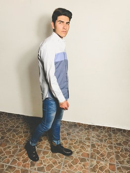 Man In White And Grey Dress Shirt And Blue Fitted Denim Jeans Outfit