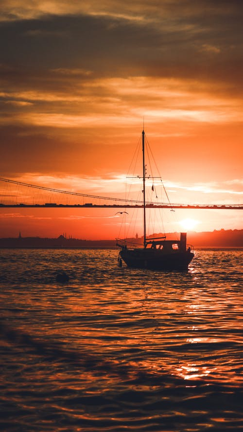 Sailing yacht floating at sunset time