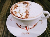Photo of White and Brown Frappe on Ceramic Tea Cup