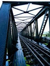 Train Track Bridge during Cloudy Skies