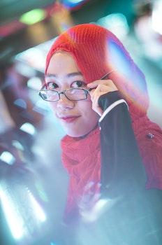 Woman Holding Her Black Framed Eyeglasses