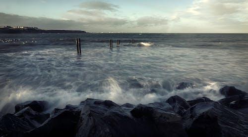 Sea Waves Crashing on Brown Wooden Dock