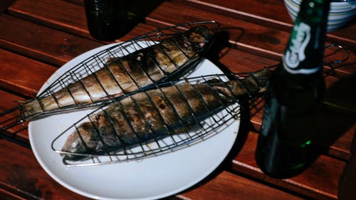 Free stock photo of beer bottle, fish, grilled