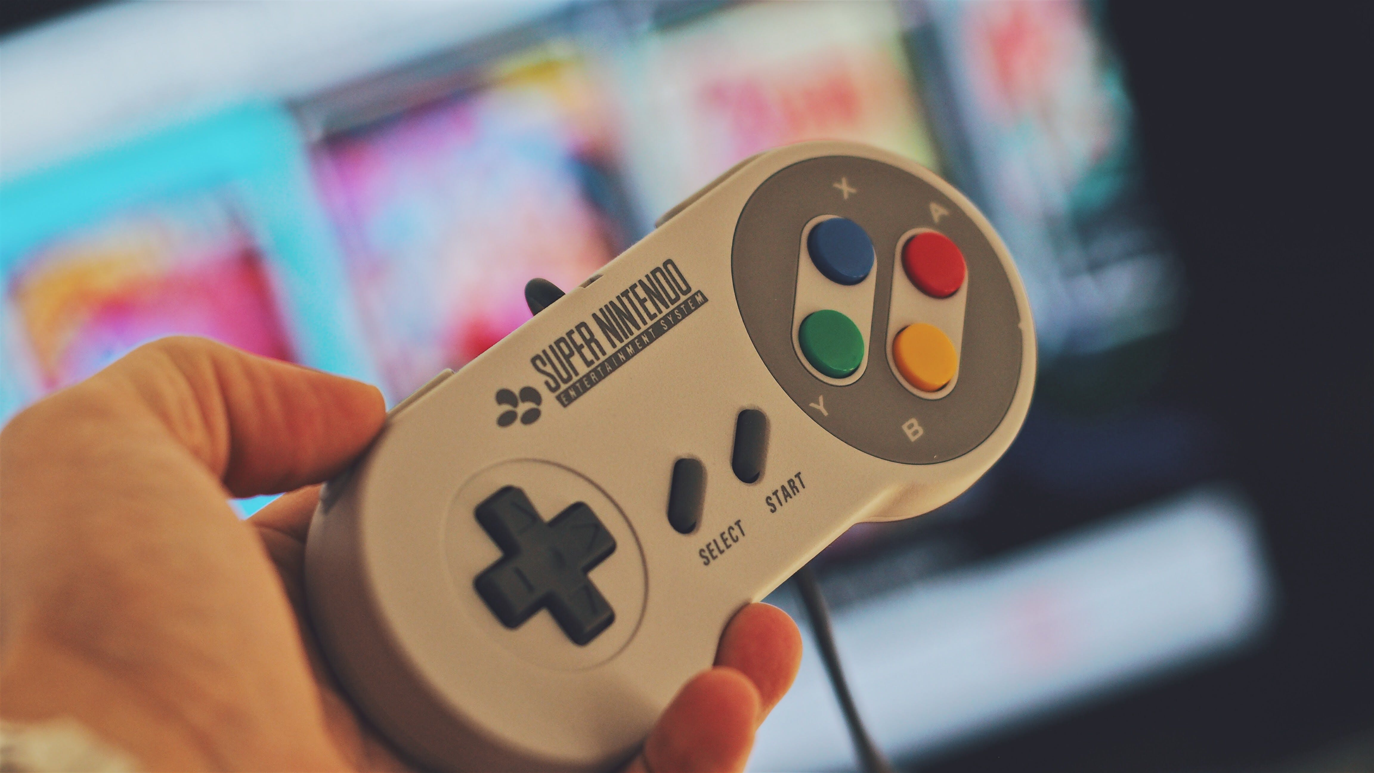 Person Holding White Snes Controller