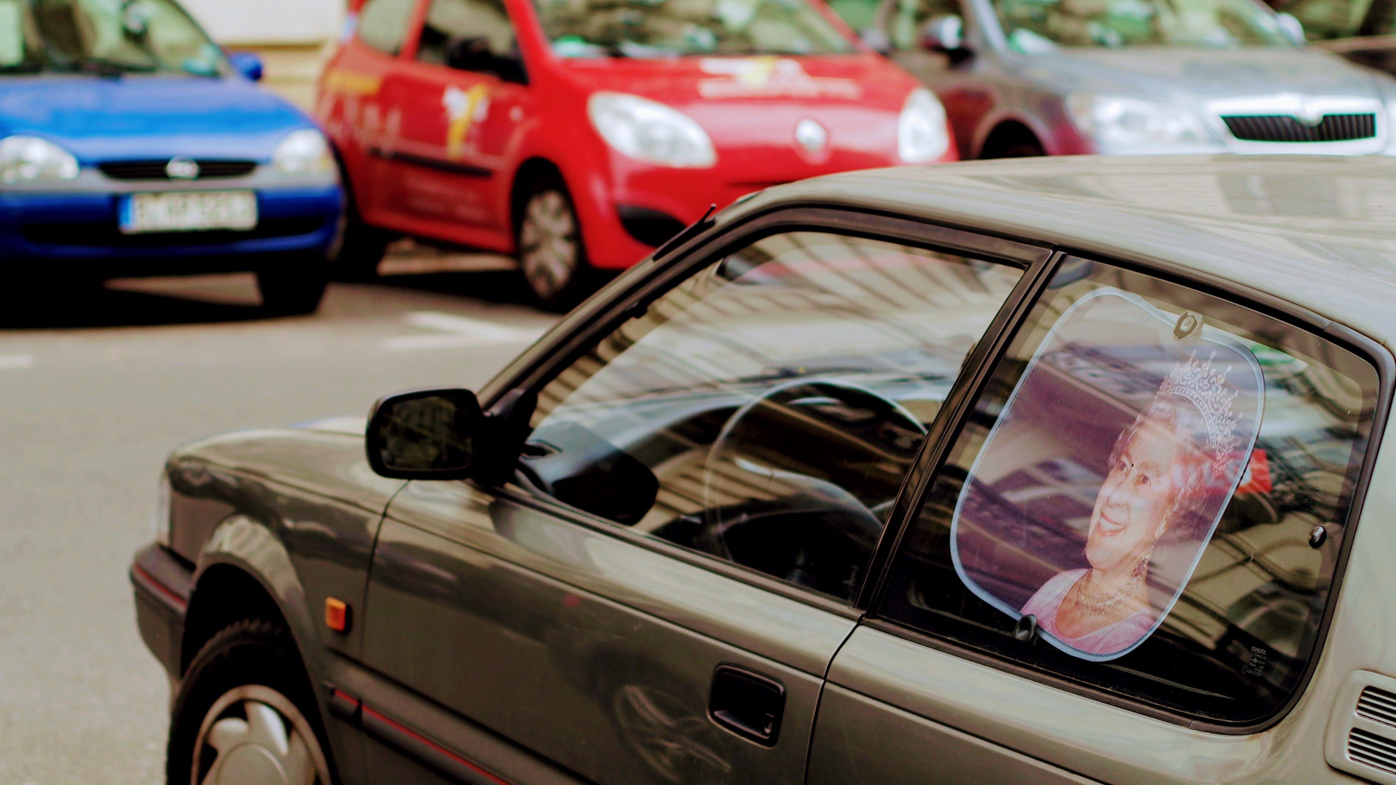Gray Car With Queen Elizabeth Photo Window Visor Poster