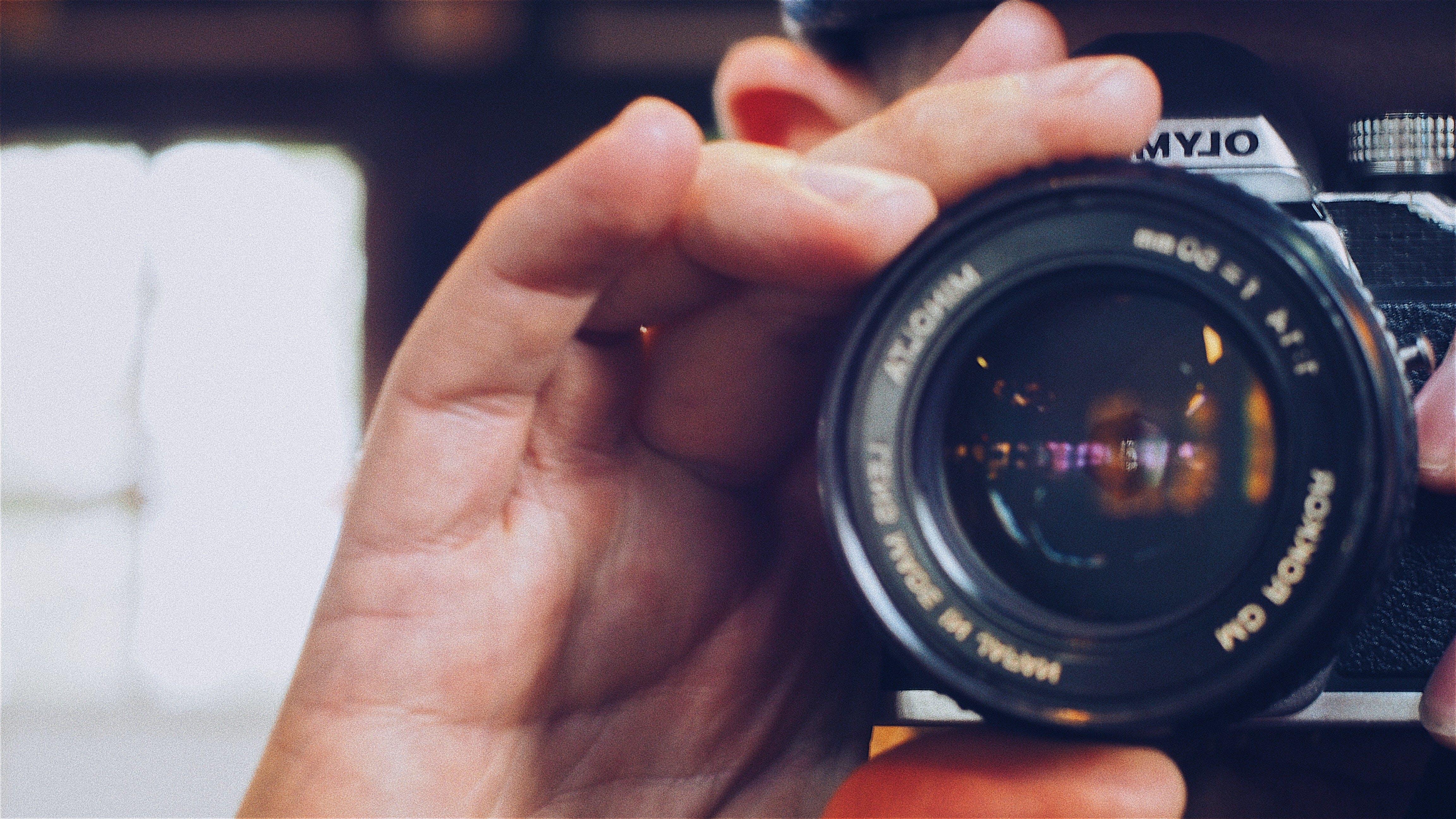 Person Holding Olympus Milc Camera