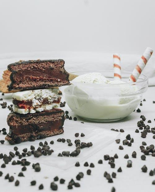 Chocolate Cake With White Cream and White Cream on White Ceramic Bowl