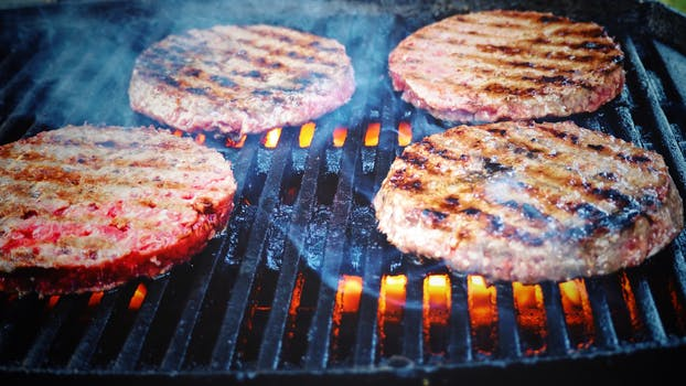 Shallow Focus Photo of Patties on Grill