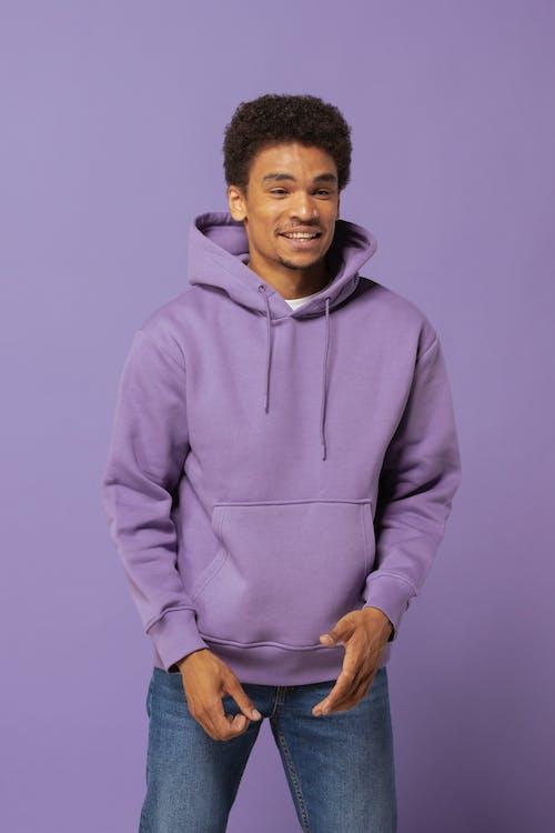 A Man Wearing a Purple Hoodie