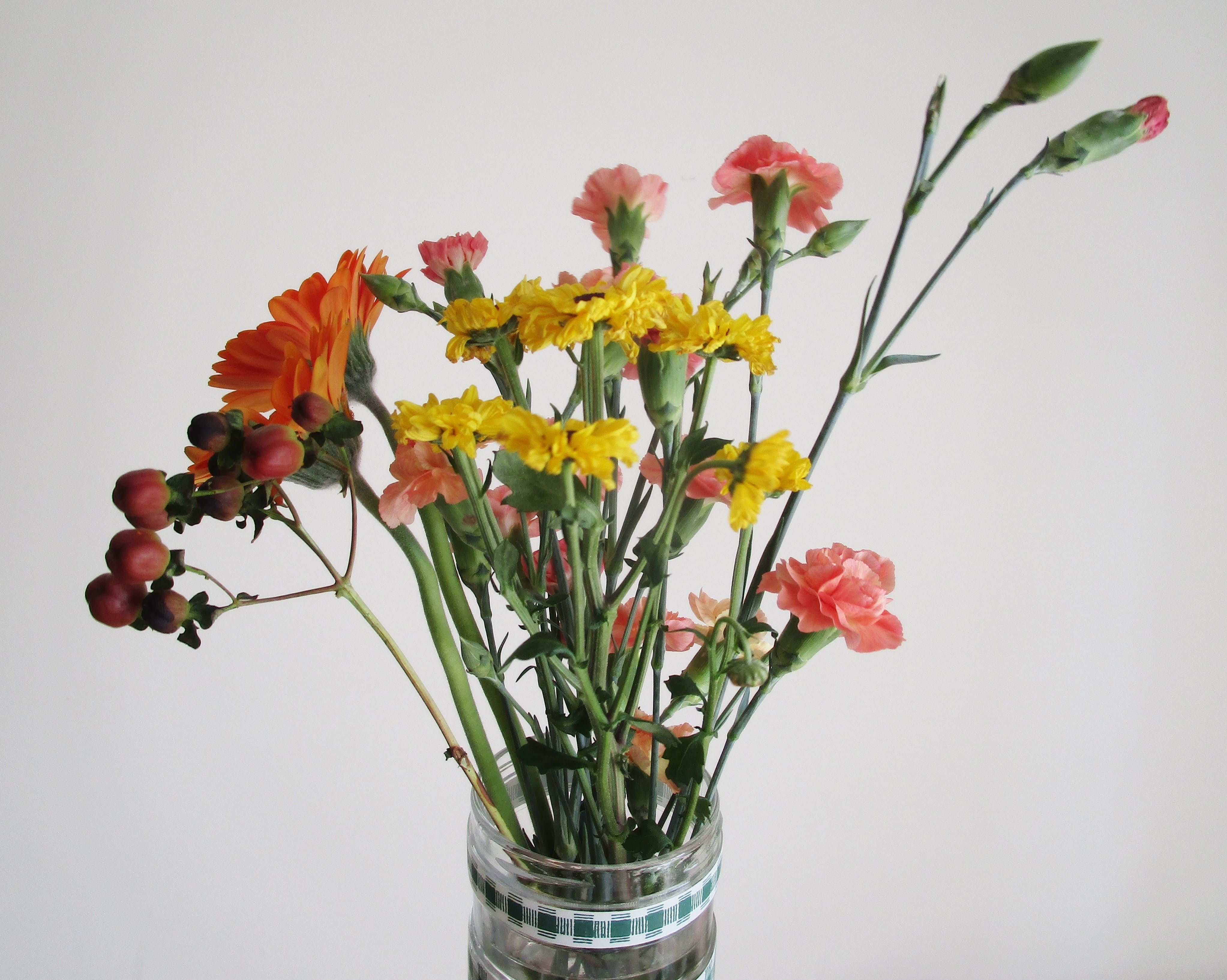 Clear Glass Vase With Red and Yellow Flowers