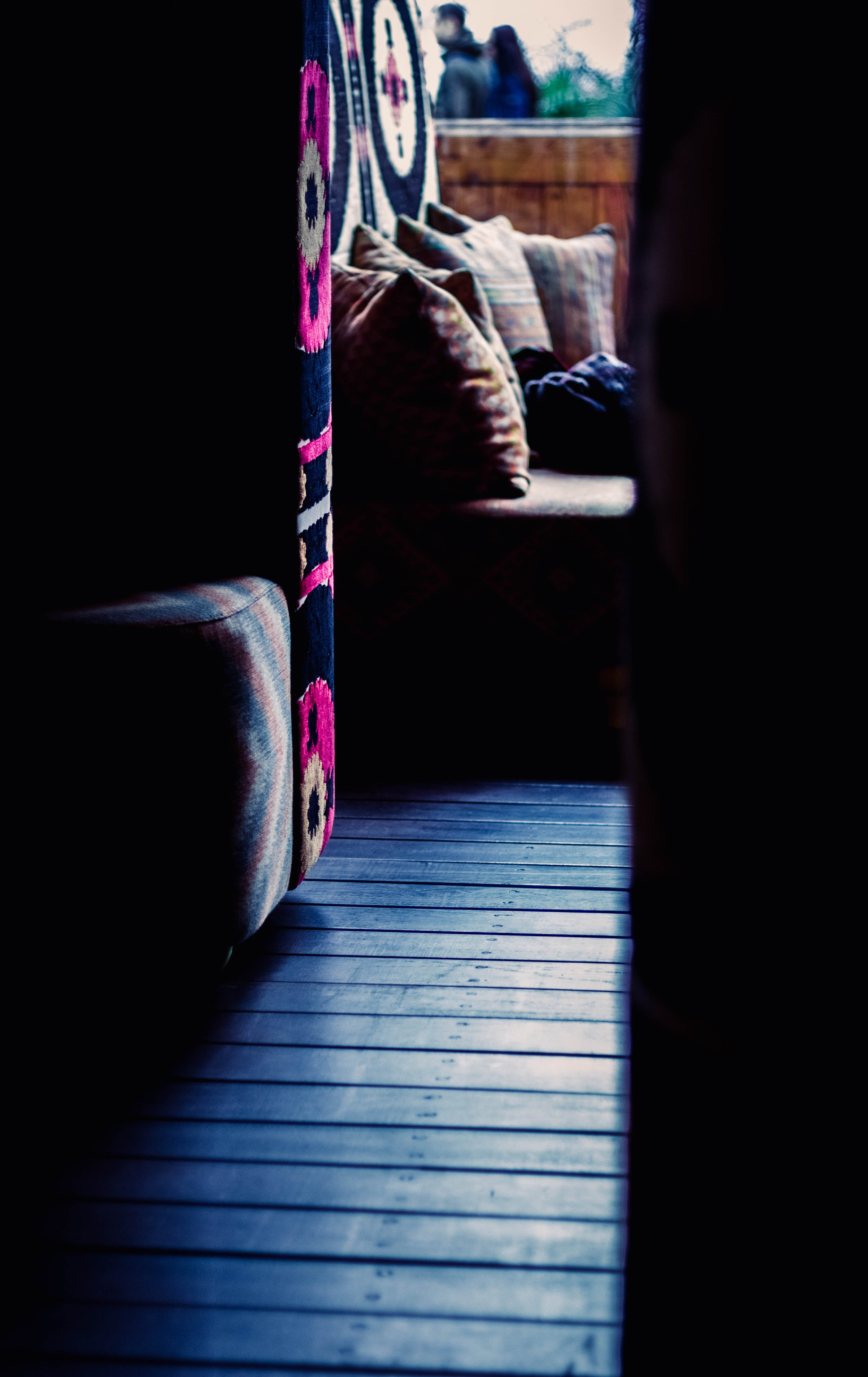 Close Up Photograph of Sofa Chair Near Round Ottoman