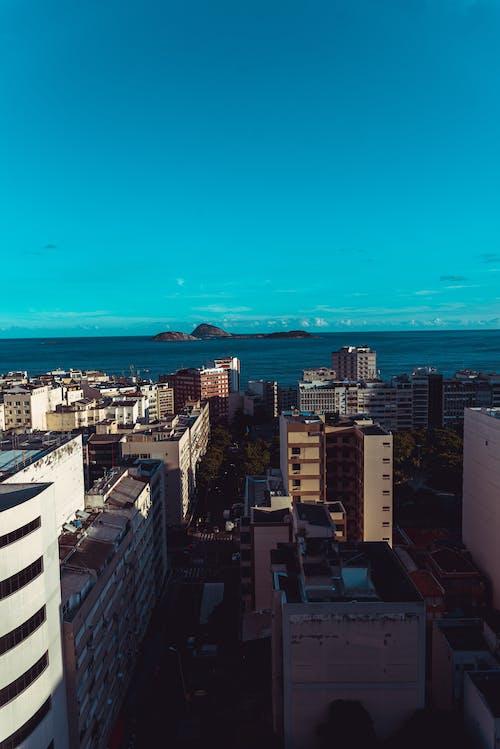 Безкоштовне стокове фото на тему «земляні шпалери, місто, океан»