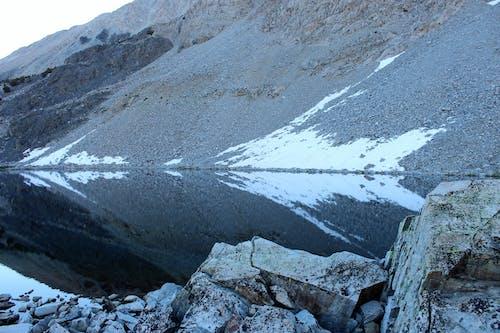 Photos gratuites de cailloux, neige, reflet