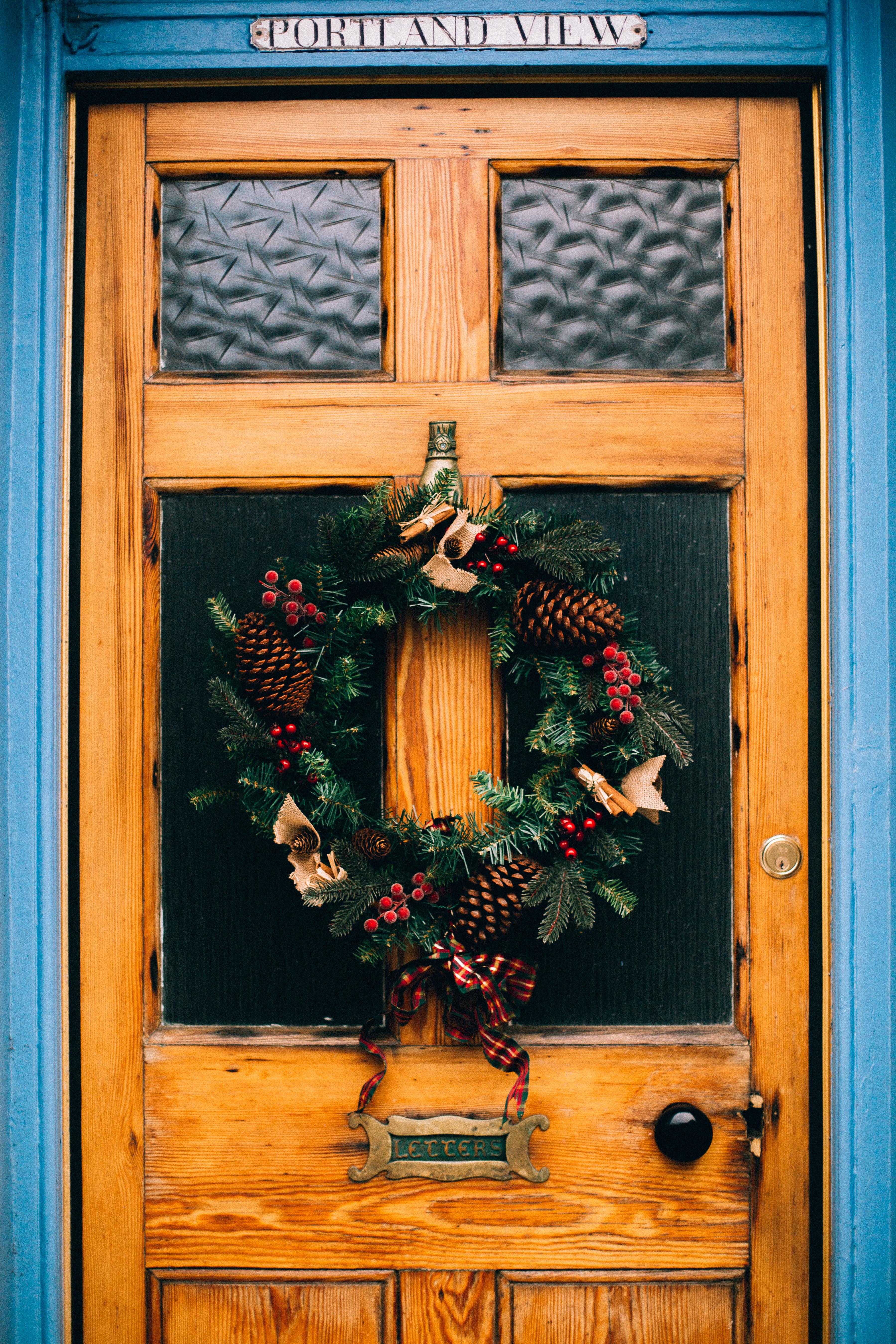Brown Wooden Door With Pine Cone Wreath