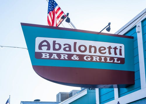 Gratis arkivbilde med Amerikansk flagg, restaurant, signere