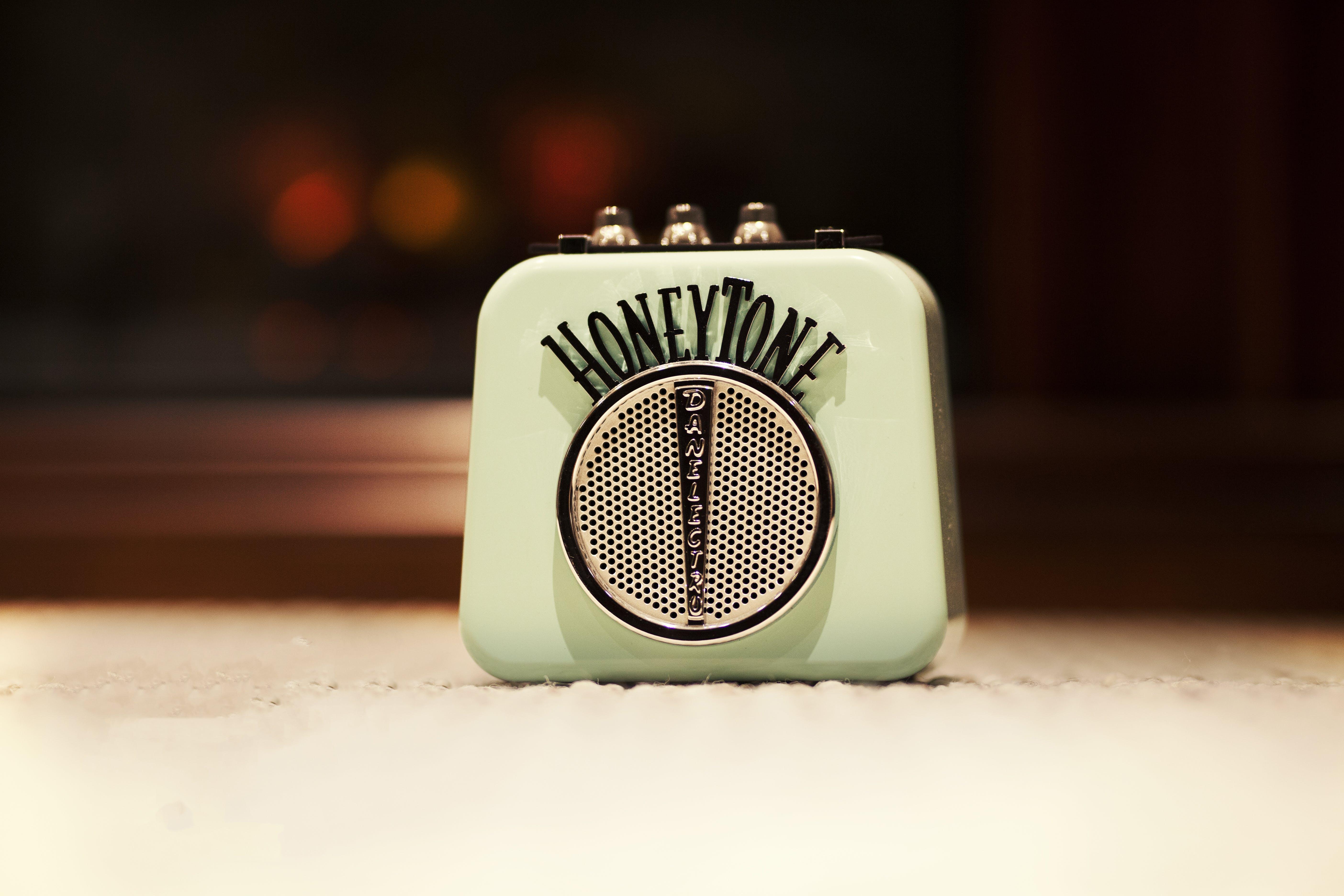 Selective Focus Photography of Honey Tone Mini Amp