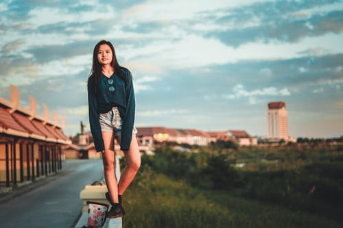 Woman Standing On Edge Of Wall