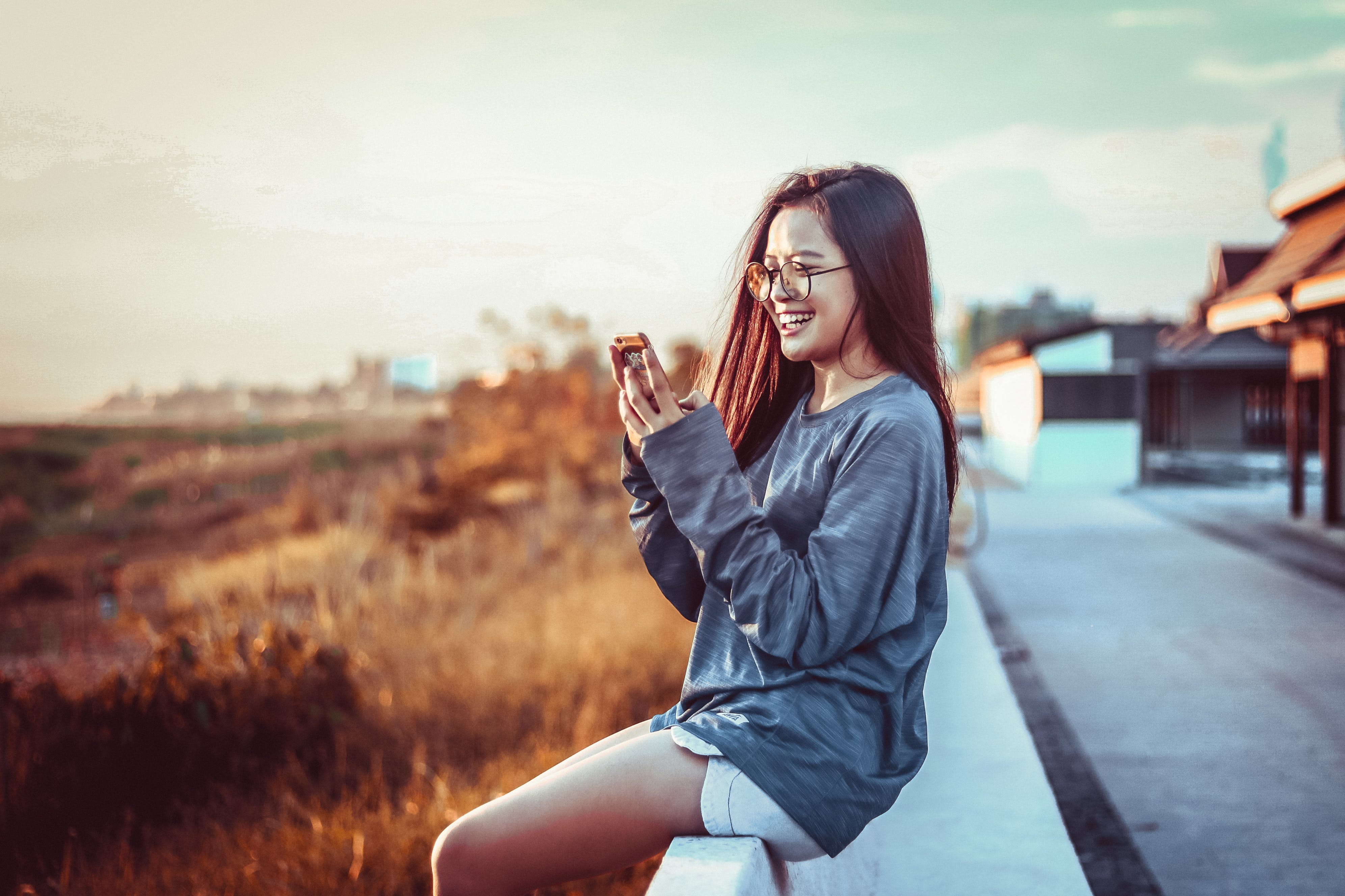 Woman Sitting Using Phone