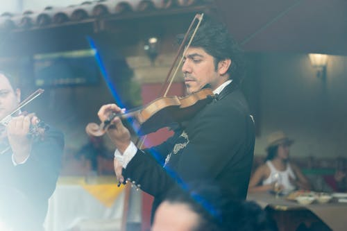 Man in Black Suit Playing Violin