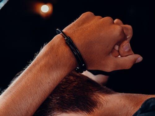 Person Wearing Black Leather Bracelet