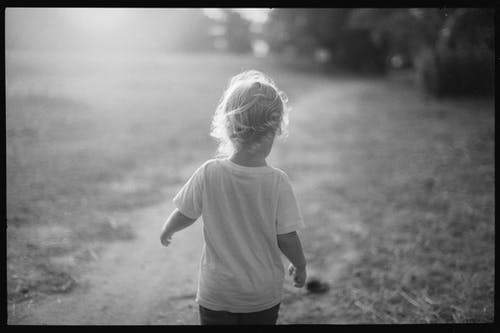 Little child standing in park