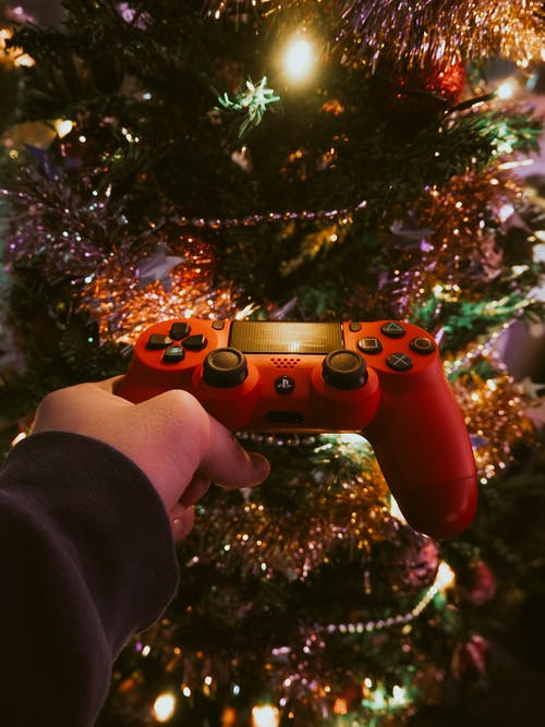 Person Holding Red Sony Wireless Ps 4 Game Controller