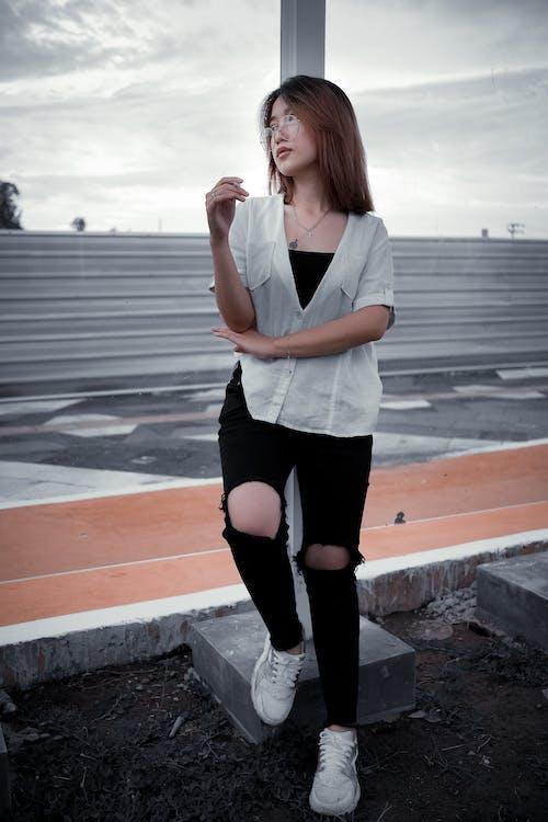 A Woman Wearing a White Shirt and Black Pants