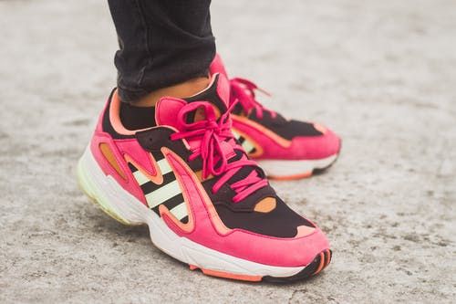 Close-Up Photo of Black and Pink Sneakers