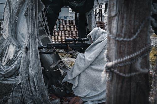 Fotos de stock gratuitas de adulto, Ametralladora, arma