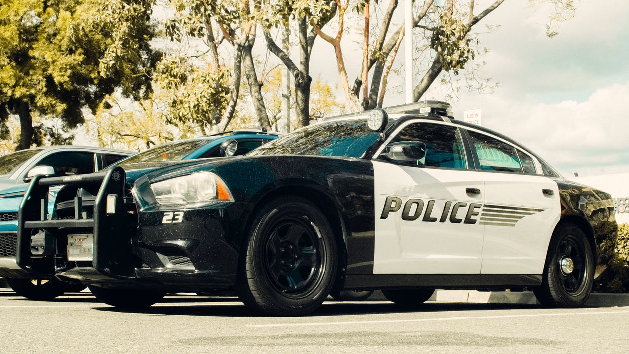 Black and White Police Car on Road