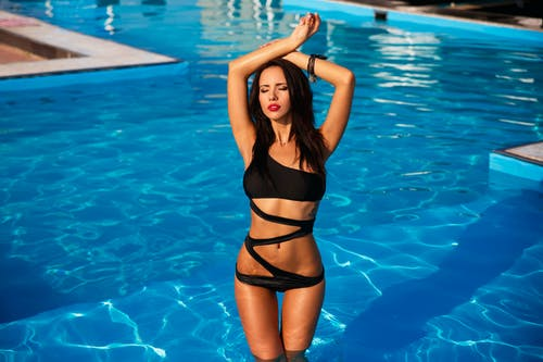 Woman in Black Swimsuit at the Pool