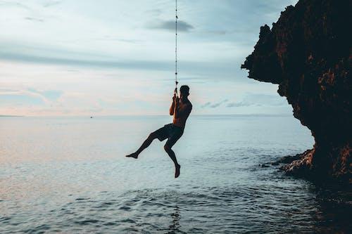 Photos gratuites de activité, balançoire, bord de mer