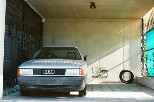 Silver Audi a 4 Coupe Parked Beside a Wall