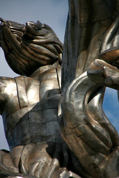 Grey Concrete Statue Under Blue Sky