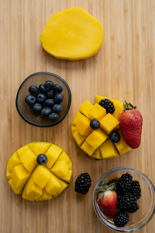 Sliced Fruit on Brown Wooden Surface