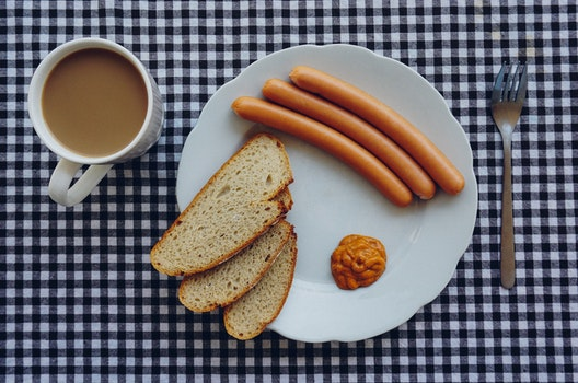 Sausages, Bread and Coffee on Table