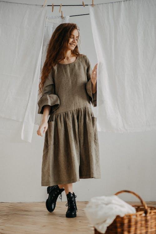 Woman in Gray Long Sleeve Dress Standing