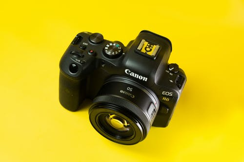 A Branded Digital Camera on a Yellow Surface