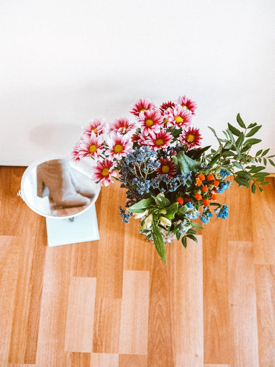 Pink and White Flowers on Brown Wooden Table