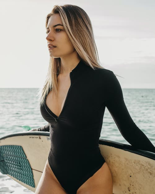 Woman in Black Long Sleeve Shirt Sitting on Boat