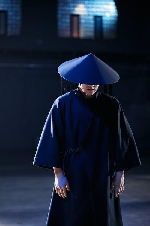 Man in Blue and Black Hoodie